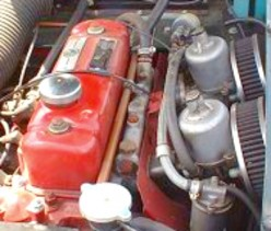 As I remember there were 2 SU Carburetors on most Jaguar and MG engines during that time