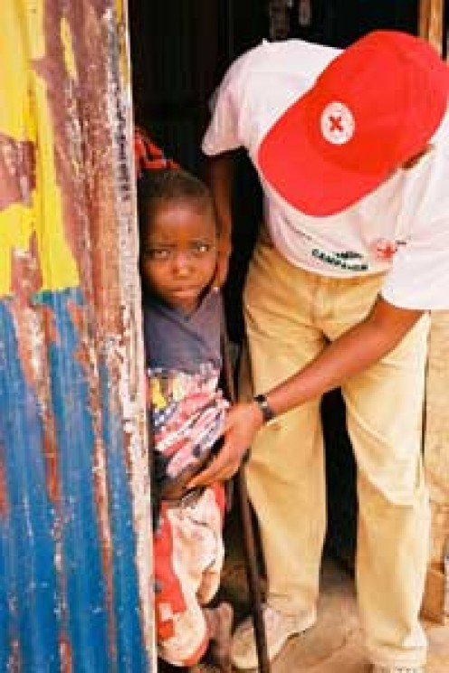 A Kenya Red Cross volunteer from the Kajiado branch, walks door to door registering children who need measles vaccinations and encouraging mothers to bring their children to the closest vaccination post.