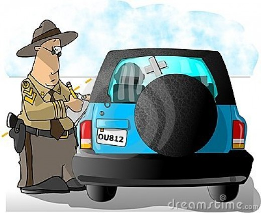 State Trooper writing a ticket by Dennis Cox@Dreamstime.com