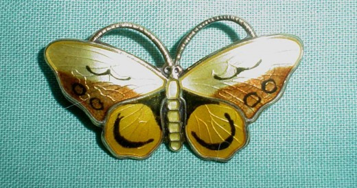 An enamel silver brooch by Opro Norway