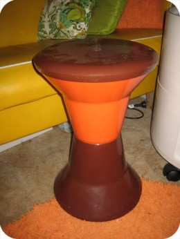 Orange and brown Caroma stool