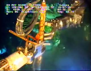 Look closely on the right, you will see the arm which is being remotely operated.