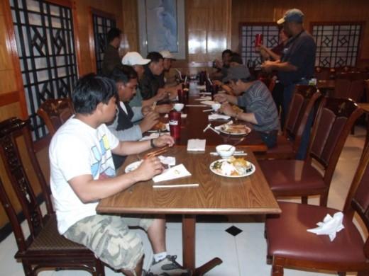 Sailors enjoying a sumptous dinner at Asian Buffet Restaurant (Le Marque, New Orleans)