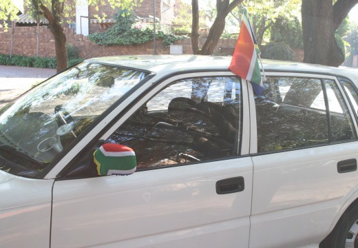 "Our car with the flag decorations. Note the ""socks"" on the wing mirrors!. Photo Tony McGregor"