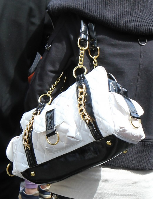 In Japan about the only rule for handbags is that they must be BIG! A black and white bag is just as eye catching as a colored bag. Just remember it might be difficult to find your iPod Nano in such a big bag!