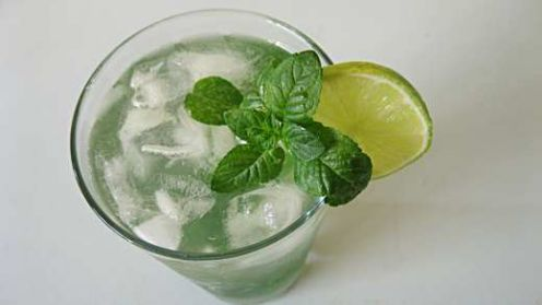 A tall glass of homemade iced minty limeade.