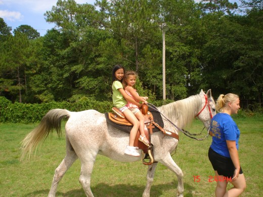Lexi and Madison riding an old Arabian mare.