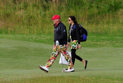 John Daly of the USA walking with his girlfriend Anna Cladakis during practice for the 139th Open Championship on the Old Course, St Andrews on July 12, 2010 in St Andrews, Scotland.    (July 11, 2010 - Photo by Stuart Franklin/Getty Images Europe)
