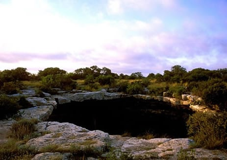 DEVIL's SINKHOLE            Rock Springs, Edwards County, Texas      (Photo courtesy Texas Parks and Wildlife Department)