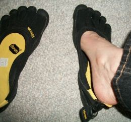 To put Five Finger shoes on, you should put them flat and crawl into them.