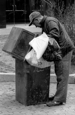 The usual image of poverty in N. America is shown in this photo and there is no connection with terrorism here. This person is looking for recyclables or food.
