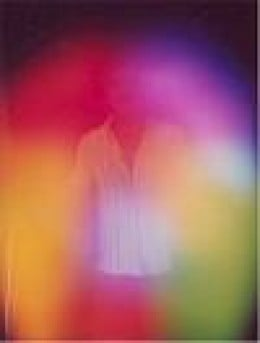 Here is a Kirlian photograph of a human aura.  Note the person in the middle.  The colours are representative of his or her character.  As you can see, we're not wholly contained within our physical bodies