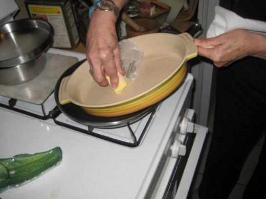 Melt your stick of butter into a 2 1/2 Quart Casserole Dish.