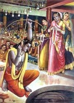 Arjuna aiming at the rotating metal fish's eye. The trick was to hit the fish's eye with the arrow, while looking at the reflection of fish in water.