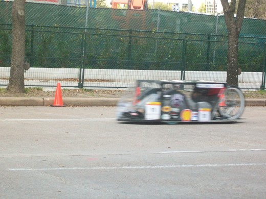 A prototype car speeding by