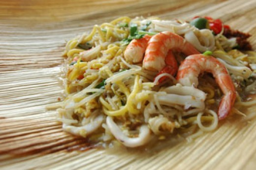 Fried Hokkien Prawn Mee on an Opeh leaf.