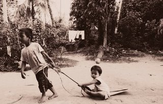 """Children playing a game of """"tarek Upih""""."""