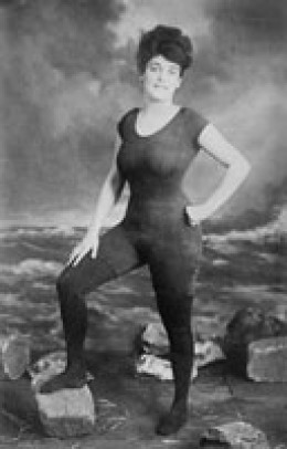 """Annette Kellerman modeling her """"indecent"""" bathing suit.       """"... styling herself as an exotic mermaid, she flaunted her Australian identity, uttering the bushman's 'coee-ee' as she leapt from the high board.""""       Stephen, Goad"""