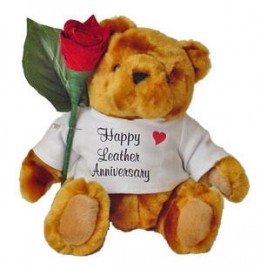Stuffed bear with leather rose