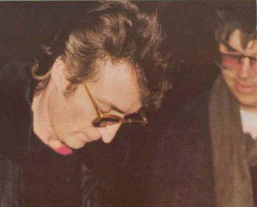 John Lennon signing an autograph for Mark Chapman, hours before Chapman shot and killed him. What a strange and sad image.