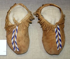 Quapaw men's beaded moccasins, Oklahoma, ca. 1900, collection of Oklahoma History Center - August 2009 Author: Uyvsdi I, the copyright holder of this work, hereby release it into the public domain.  http://en.wikipedia.org/wiki/File:Quapaw_mocs_1900_