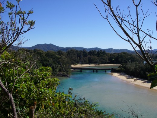 A river estuary and mountains in the far distance from a Sawtell lookout