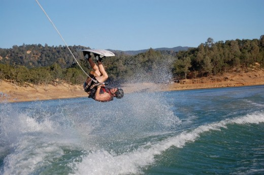 Mark upside down trying to pull off a flip on the wake board