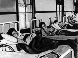 Foreground is MARY MALLON who is pictured in a hospital bed during her quarantine