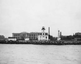 North Brother Island is a 13-acre spit of land in the East River, between the Bronx and Riker's Island, New York.  This place where TYPHOID MARY was quarantined is now a wildlife sanctuary.
