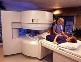 Radiologist setting up the patient for MRI.