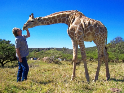 My boyfriend Tony chats to a young giraffe at Areena Riverside Resort.  Photo by Teresa Schultz.