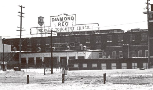 This is a public domain shot of the old REO Motor Car Company plant. It was a National Historic Landmark, registed  until 1985 when such status was withdrawn after demolition in 1980. The land it occupied on was no longer recognized as well. REO Town