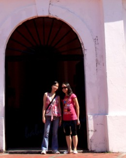 My daughters framed by a doorway. Aren't you curious to find out what is behind that door?