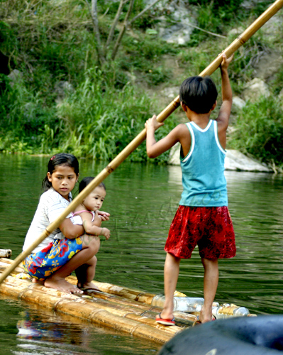 bamboo pole and raft framing the children