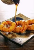 Picarones: commonly served with honey syrup.
