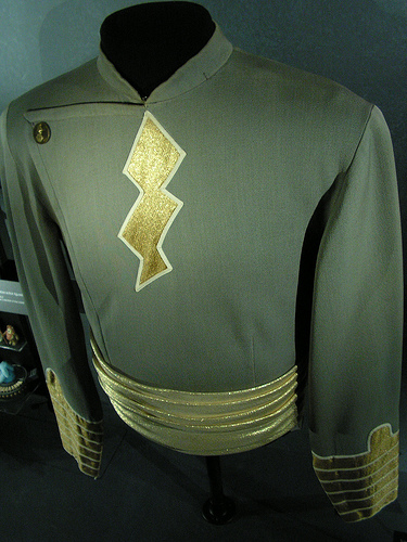 An old Captain Marvel shirt from the movie serials. Images public domain. Costumes may be very simple.