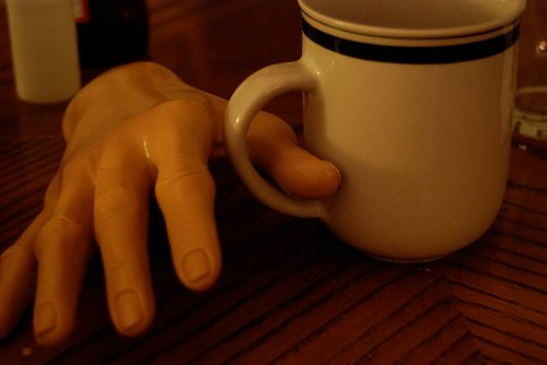 Arthritis Patient trying to hold a teacup.
