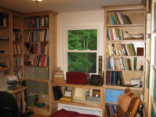 The floor-to-ceiling book cases are made entirely of red maple (natural color) and the trim around the window is aspen, which has been painted white.