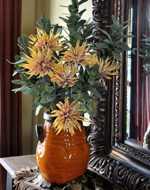Make a statement with a single urn style container on a countertop.