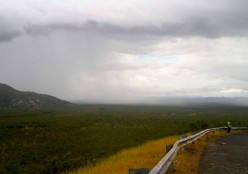 Curtains of rain moving across a deserted landscape