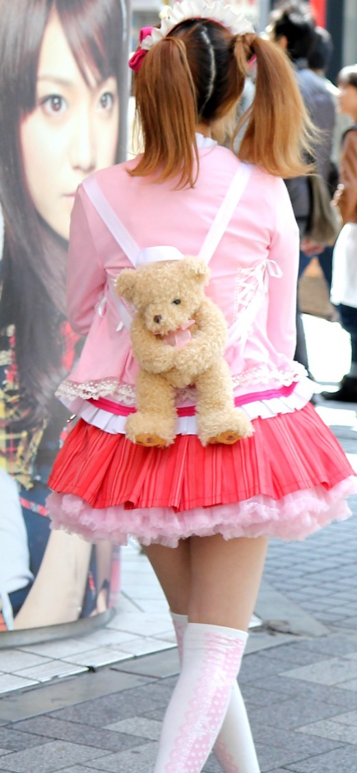 OK so she's never going to be allowed to dress like this for school, but this girl's bear backpack has to be the cutest thing ever!