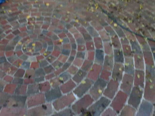 Some of Sarah's father's beautiful stone paving. He loves his job and it shows here, there are some very historic bricks embedded in this paving. .