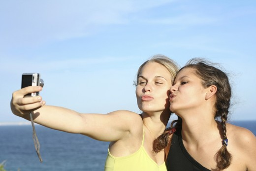 These girls are so happy to be uploading their pics to facebook... or are they? O_o