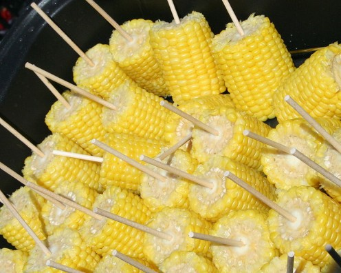 Corn on the cob, grilled in its own husk, makes a nutritious and delicious side dish.