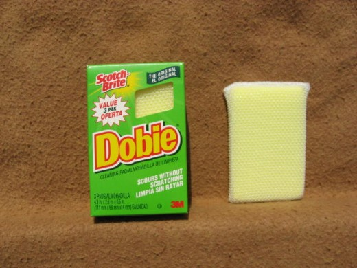 Image B - Use Dobie pads to scour the stubbornly stained surfaces of your grill without scratching them.