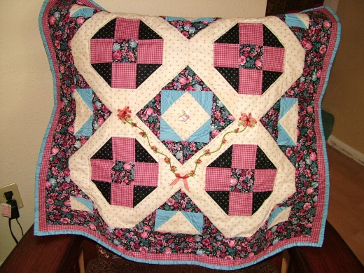 quilt with silk ribbon embroidery added