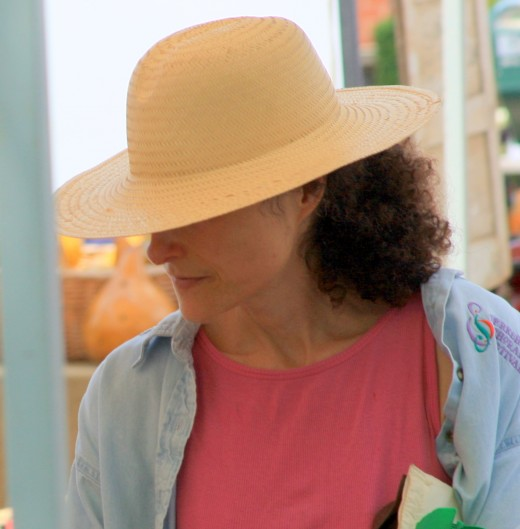 Beautiful woman at farmers' market, deedsphoto