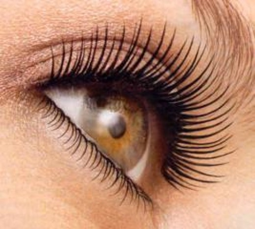 Yes, she is wearing mascara but no amount of mascara would make her eyelashes this beautiful if they weren't long and full to begin with. You can achieve this look with Stimulashfusion!
