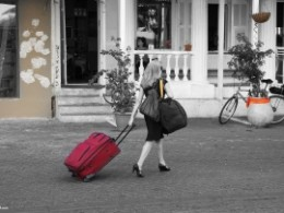 woman pulling bagcase