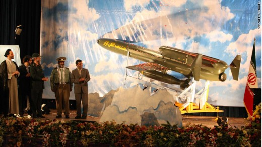 Mahmoud Ahmadinejad and his new Karrar toy which can turn Israel into a glow in the dark nuclear wasteland.